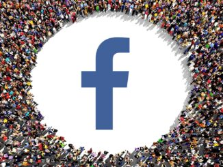 Facebook logo in surrounded by a large group of people. Image: MarketingLand, All Rights Reserved.