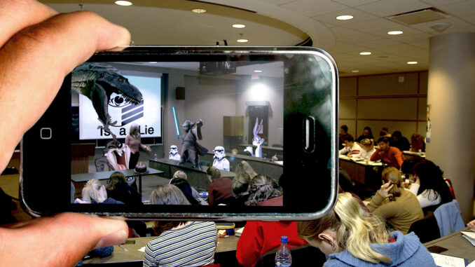 Image of augmented reality being used during class to depict various characters in the lecture room via a phone screen