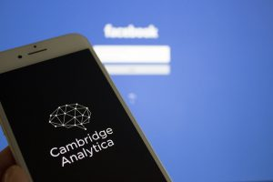 Cambridge Analytica on a device with Facebook screen
